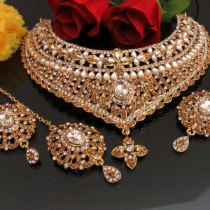 Kundan necklace set with earnings and tikka